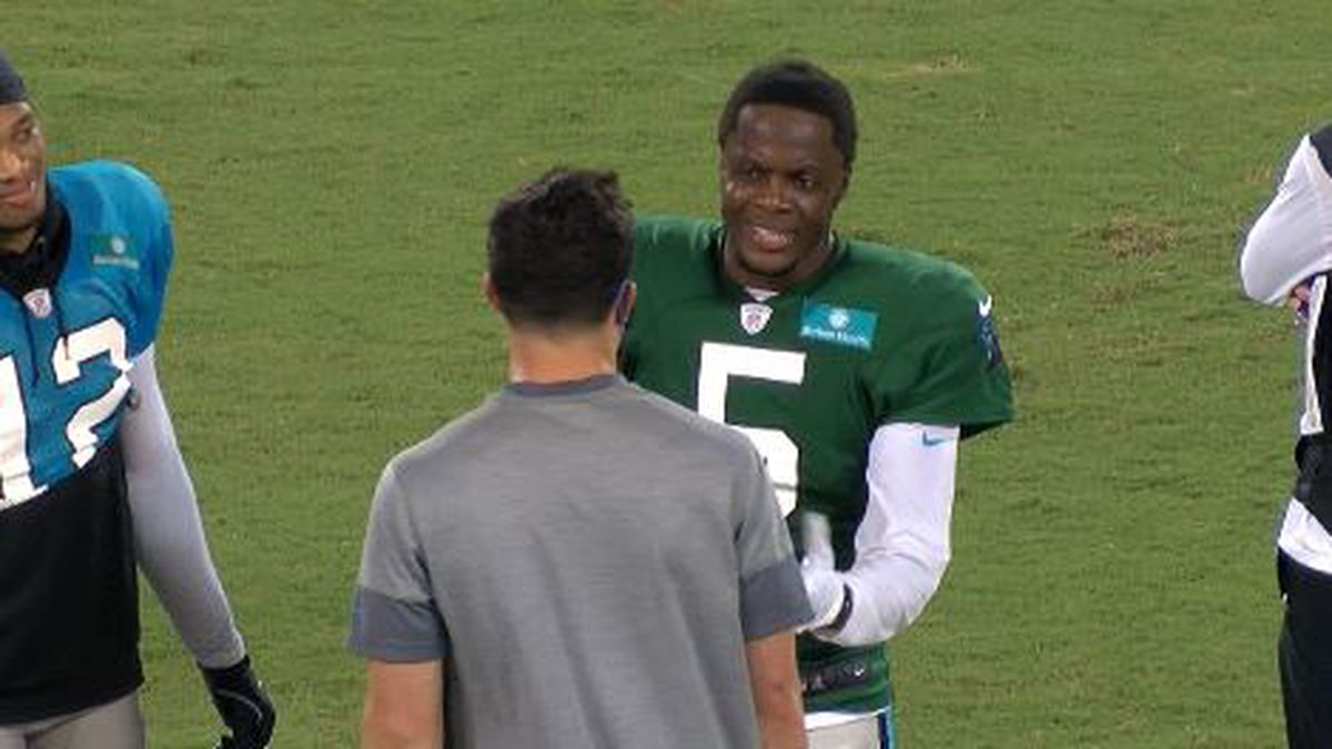 Panthers QB Teddy Bridgewater talking to Panthers great Luke Kuechly at Panthers first...