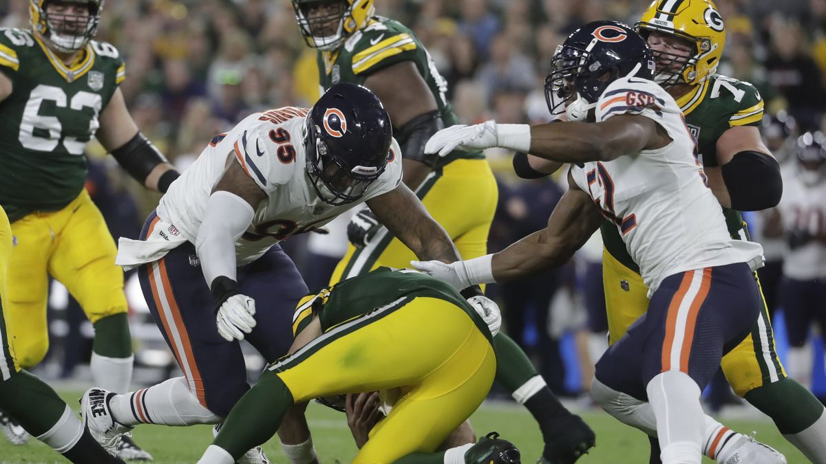 Green Bay Packers quarterback Aaron Rodgers is hurt after being sacked during the first half of...