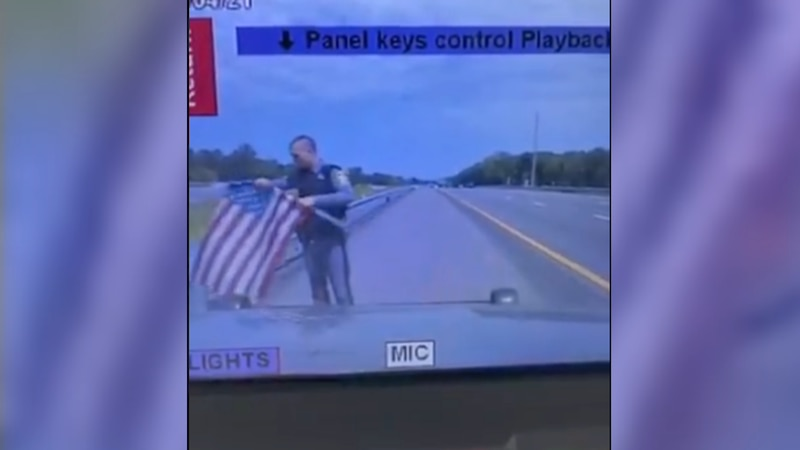 VSP Trooper M.B. LaSage stopped along I-64 Sunday to pick up an American flag laying on the...