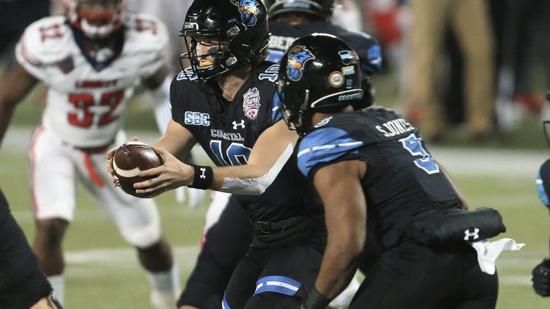 Coastal Carolina quarterback Grayson McCall (10) fakes a handoff to running back Shermari Jones...