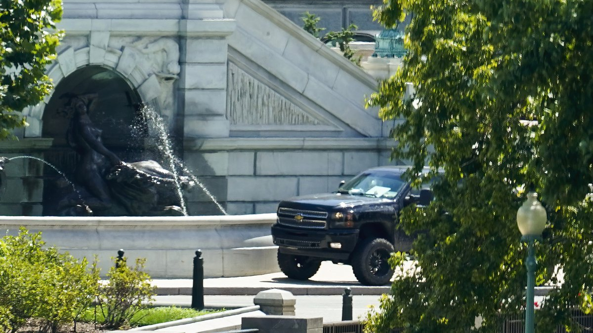 A pickup truck is parked on the sidewalk in front of the Library of Congress' Thomas Jefferson...