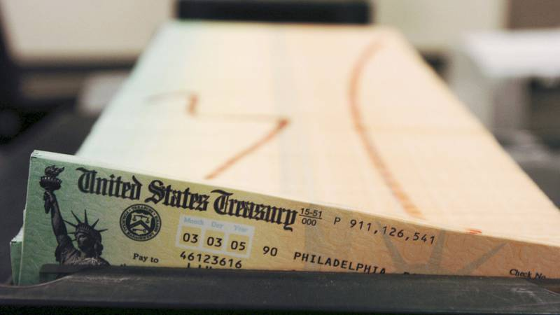 FILE - In this Feb. 11, 2005 file photo, trays of printed Social Security checks wait to be...