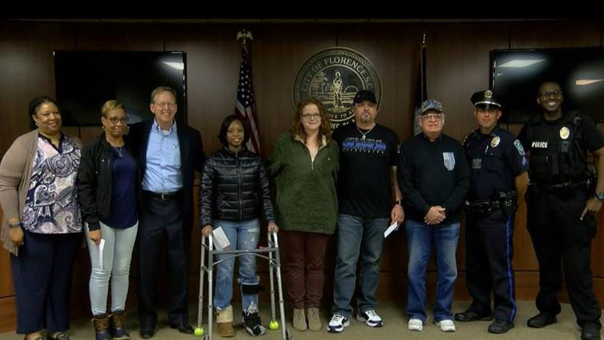 Florence police officers and families impacted by the deadly October ambush received donations...