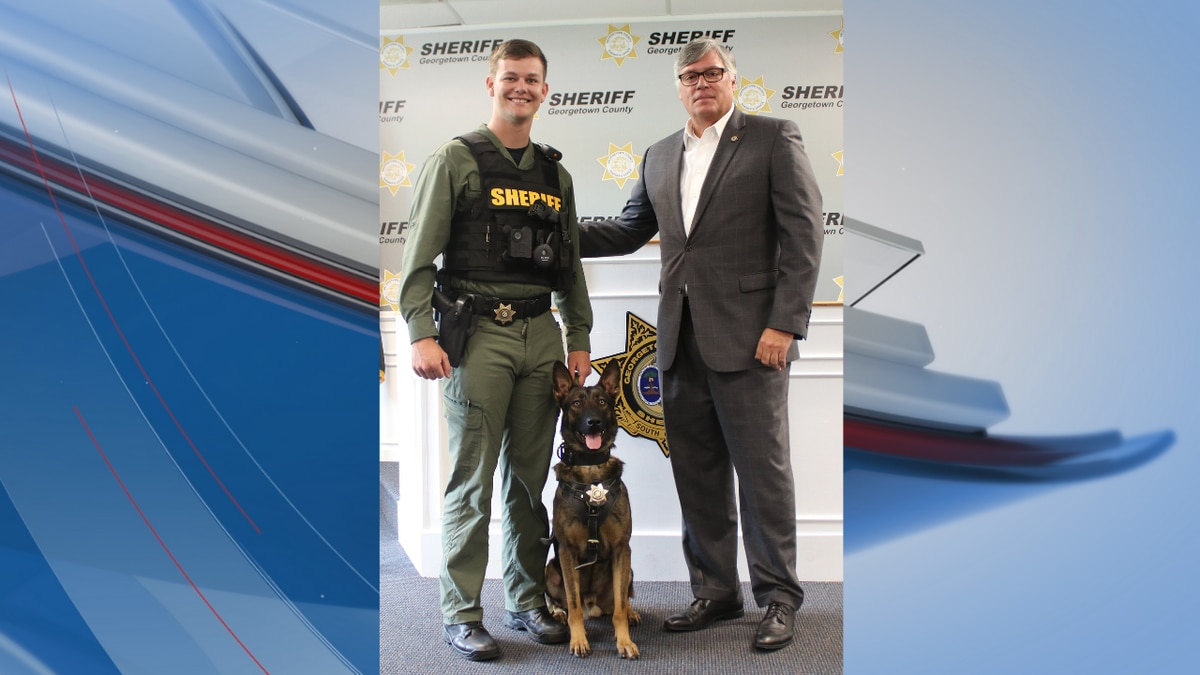 K-9 Dukat with his handler, deputy Cody Thompson, and Georgetown County Sheriff Carter Weaver