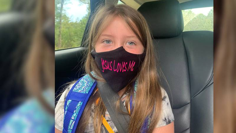 """School officials say Lydia Booth could not wear this """"Jesus loves me"""" mask."""