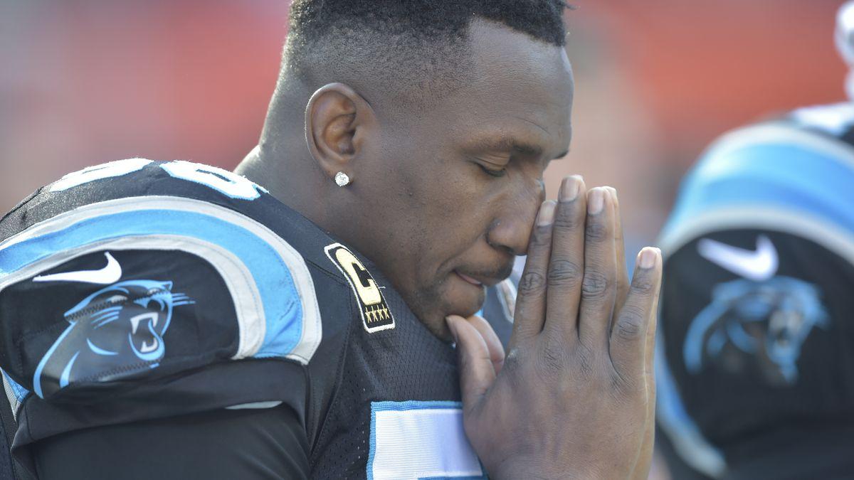 Carolina Panthers outside linebacker Thomas Davis reacts during the national anthem before an...