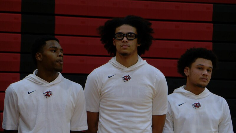 The Hartsville boys led by four-star and Xavier signee Cesare Edwards (center) defeated Aiken,...