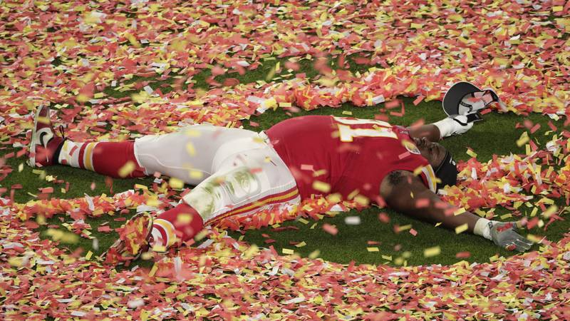 Kansas City Chiefs' Derrick Nnadi (91) plays with the confetti, at the end of the NFL Super...