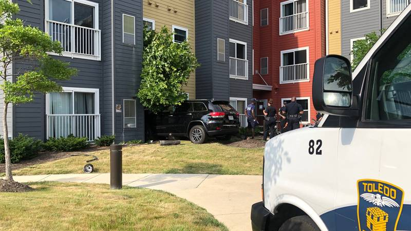 A car crashes into a Toledo apartment with a man and his dog inside