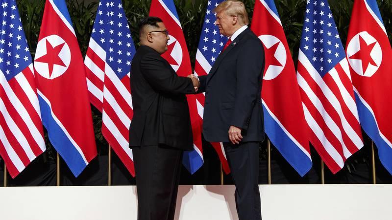 FILE - In this June 12, 2018, file photo, North Korean leader Kim Jong Un, left, and U.S....