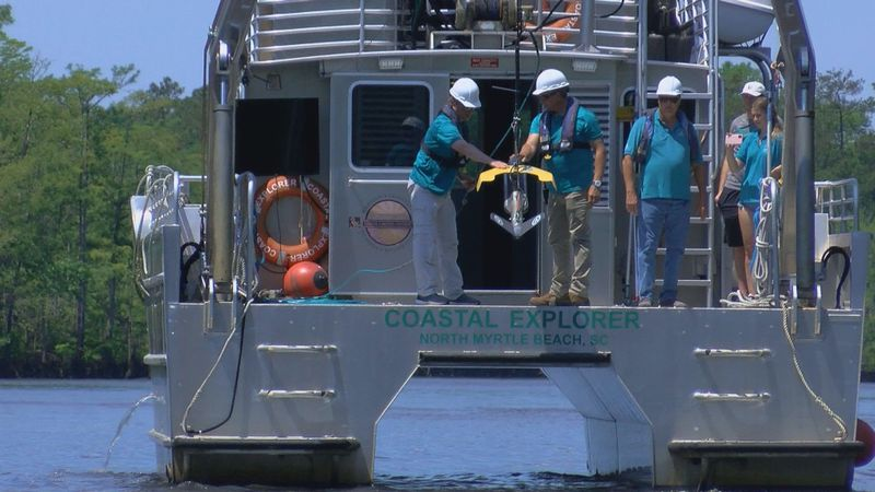 Crews deploy a side-scan sonar device into the Intracoastal Waterway. (Source: WMBF News)
