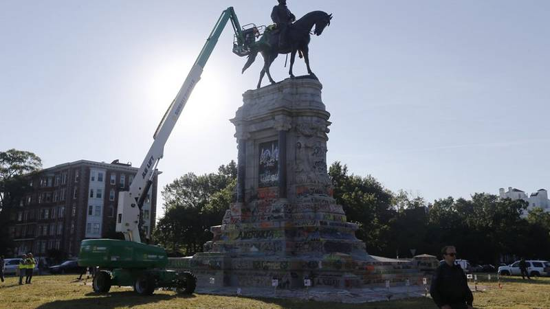 An inspection crew from the Virginia Department of General Services inspect the statue of...