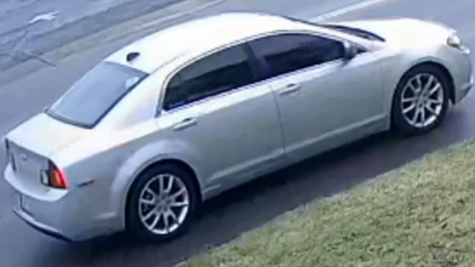 The suspect vehicle is described as a silver, four-door Chevrolet Malibu with a North Carolina...