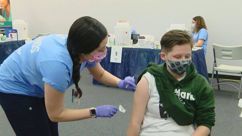 A teenager gets vaccinated at a Tidelands Health COVID-19 clinic.