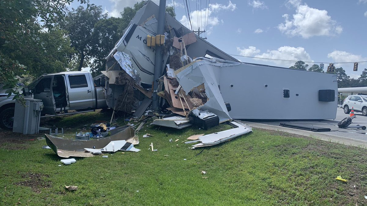 A three-vehicle crash involving a pick-up truck hauling a camper is snarling traffic Monday in...