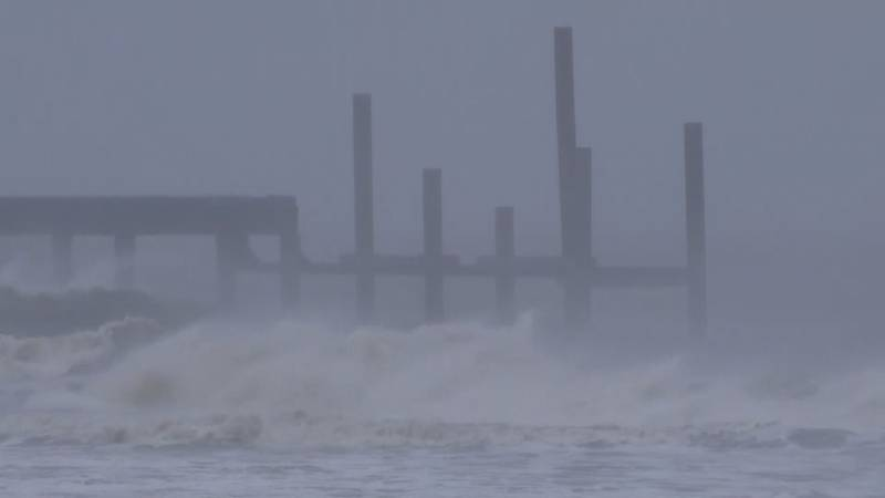 Hurricane winds causes large waves and rain in the ocean.