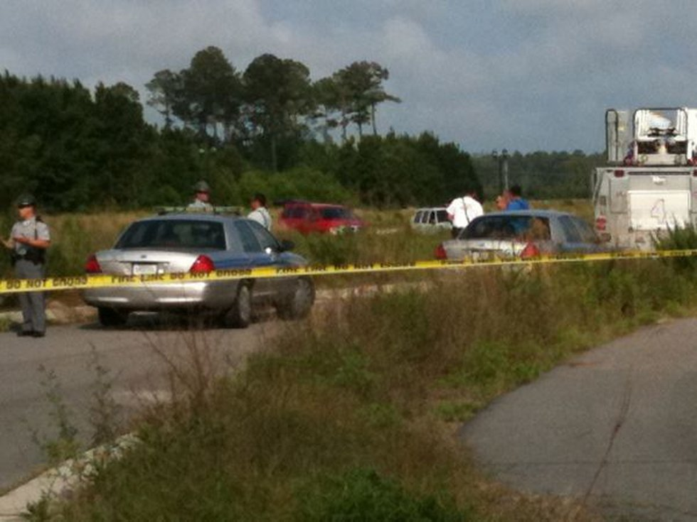 Officials on the scene of a submerged vehicle in a retention pond off of Dick Scobee Road and...