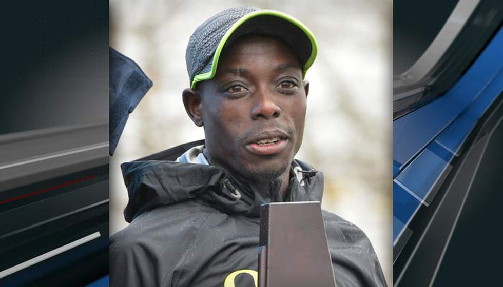 Edward Cheserek, shown here holding up the trophy for his victory in the men's NCAA Cross...