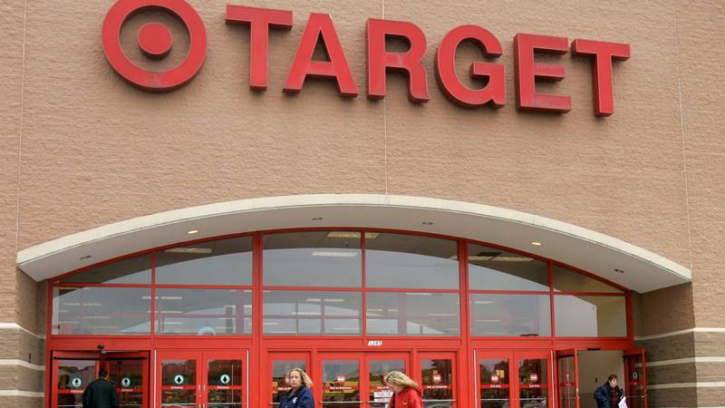 FILE - People enter and exit a Target store,  Wednesday, Nov. 7, 2007, in Mayfield Heights, Ohio.