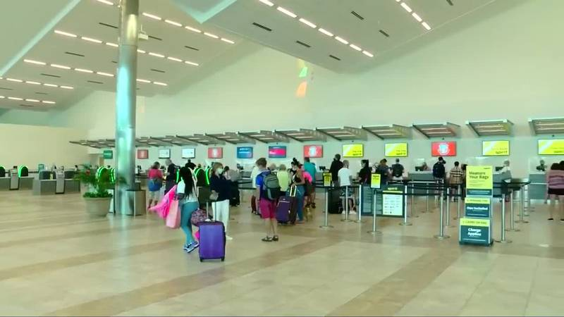 While experts say it is a risk to travel with cases on the rise, the airport says they've done...
