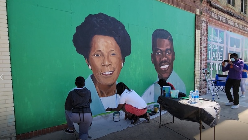 Artists were busy painting a mural in downtown Lake City during the 2021 ArtFields.
