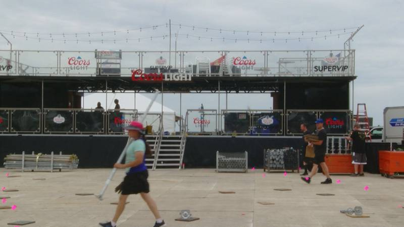 Crews with Carolina Country Music Festival continue setting up the main stage and VIP area.