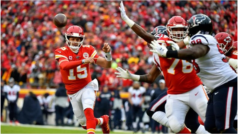 Kansas City Chiefs quarterback Patrick Mahomes (15) throws a pass during the first half of an...