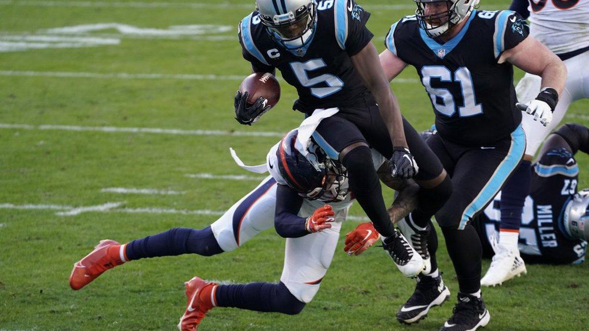 Carolina Panthers quarterback Teddy Bridgewater scores past Denver Broncos safety Justin...