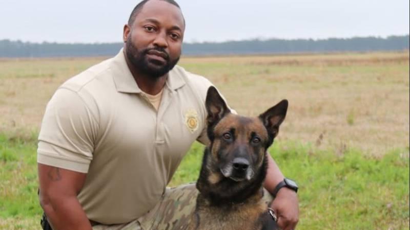 Alabama Department of Corrections K9 Jake and his handler, Sgt. Quinton Jones.