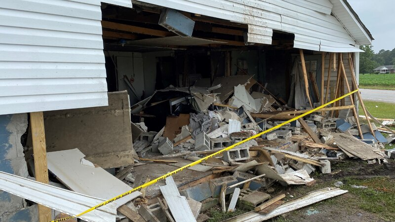 A pickup truck crashed through a home after colliding with another vehicle at High Hill and...